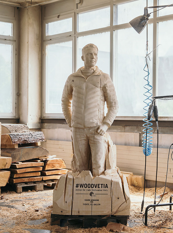 Statue of Swiss ski jumper Simon Ammann carved out of spruce