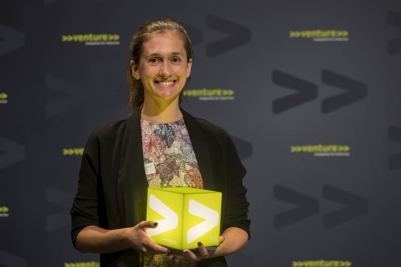 Samantha Anderson holding the award for Switzerland's most innovative start-up, won by DePoly in July 2019.