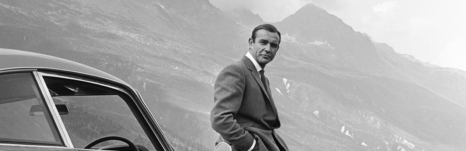 Waiting at the Furka Pass: James Bond aka 007 on his quest to hunt down Goldfinger in his Aston Martin DB5 in Switzerland.